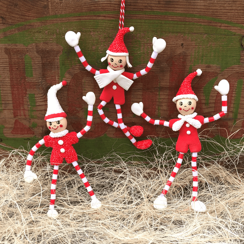 julenisser av piperensere, leire og rørperler
