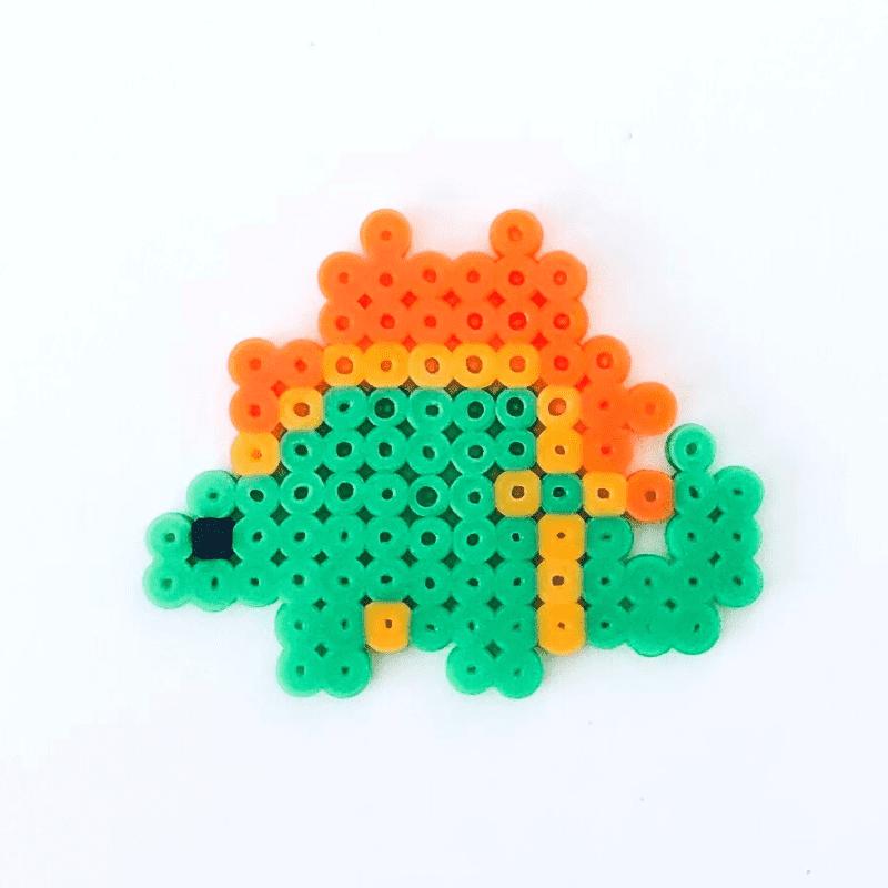 Grön dinosaurie av rörpärlor